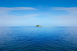 Lonley island in the sea with small lighthouse Thailand Krabi Lanta